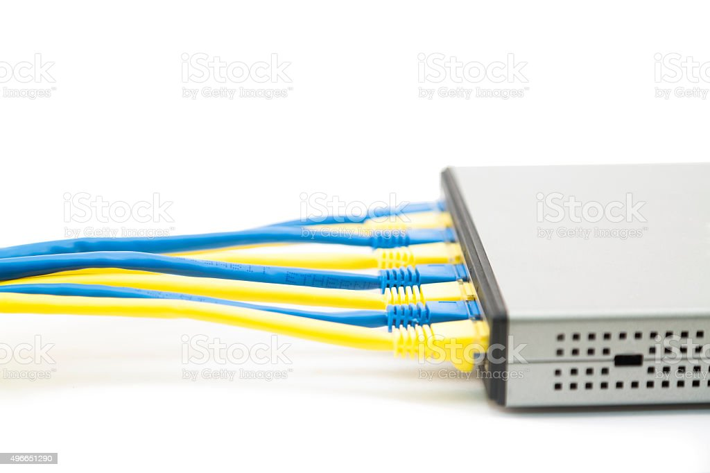 Computer network cables into switch stock photo