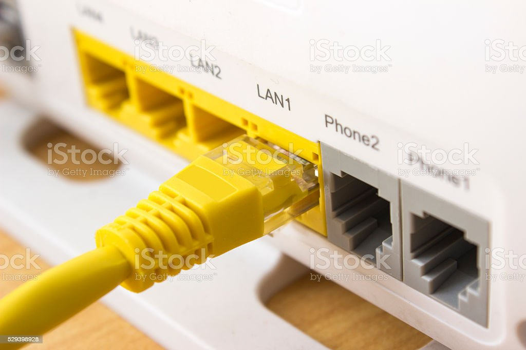 Computer network plug attached modem stock photo