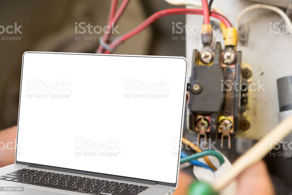 computer on hand install new air conditioner. stock photo