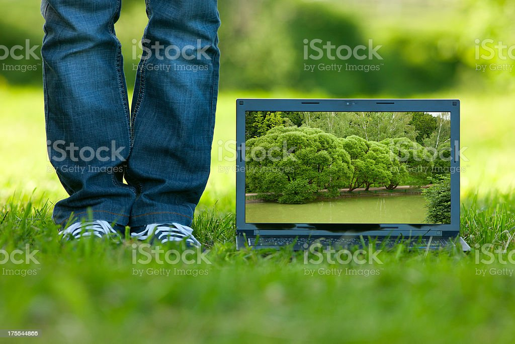 Computer on the grass stock photo