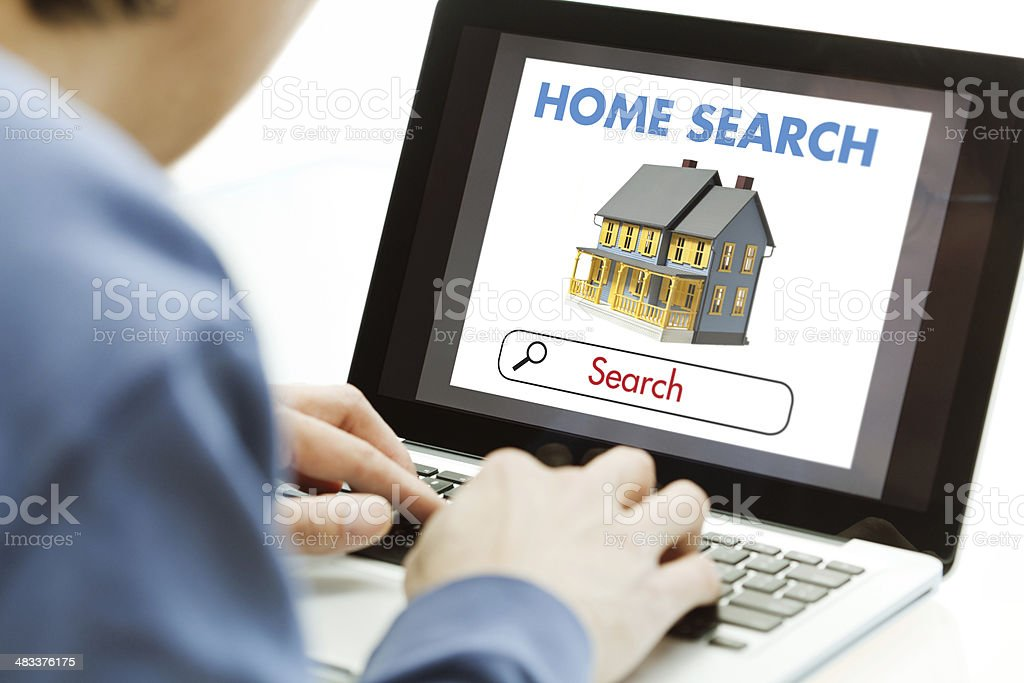 Computer Online Internet Home Searching, House Hunting for Real Estate stock photo