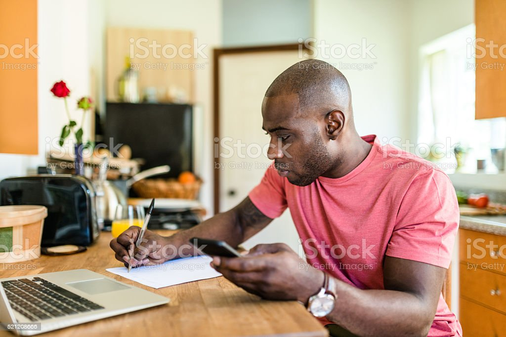 computer programmaer working from home in the kitchen stock photo