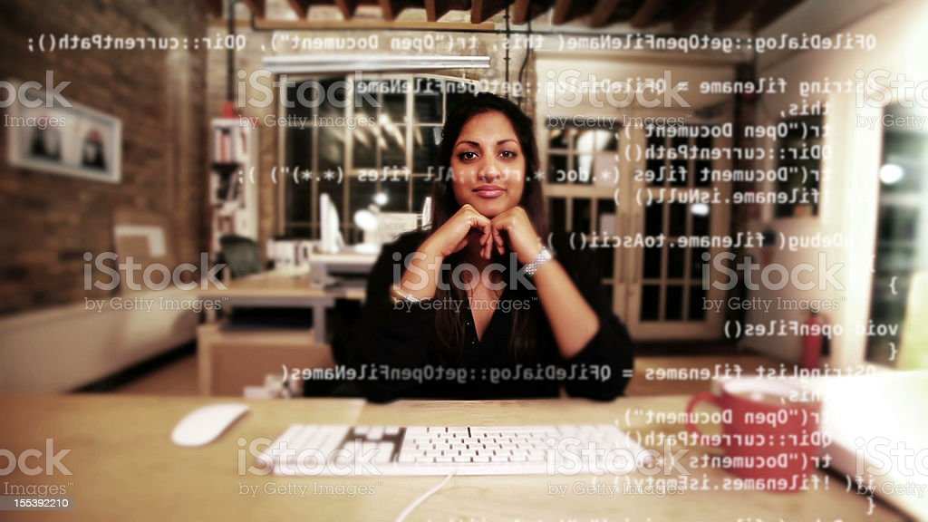 Computer programmer happy with her work stock photo