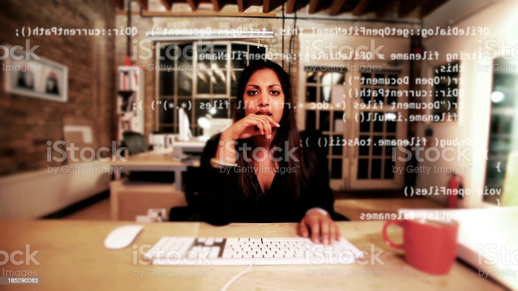 Computer programmer thinking over her code royalty-free stock photo