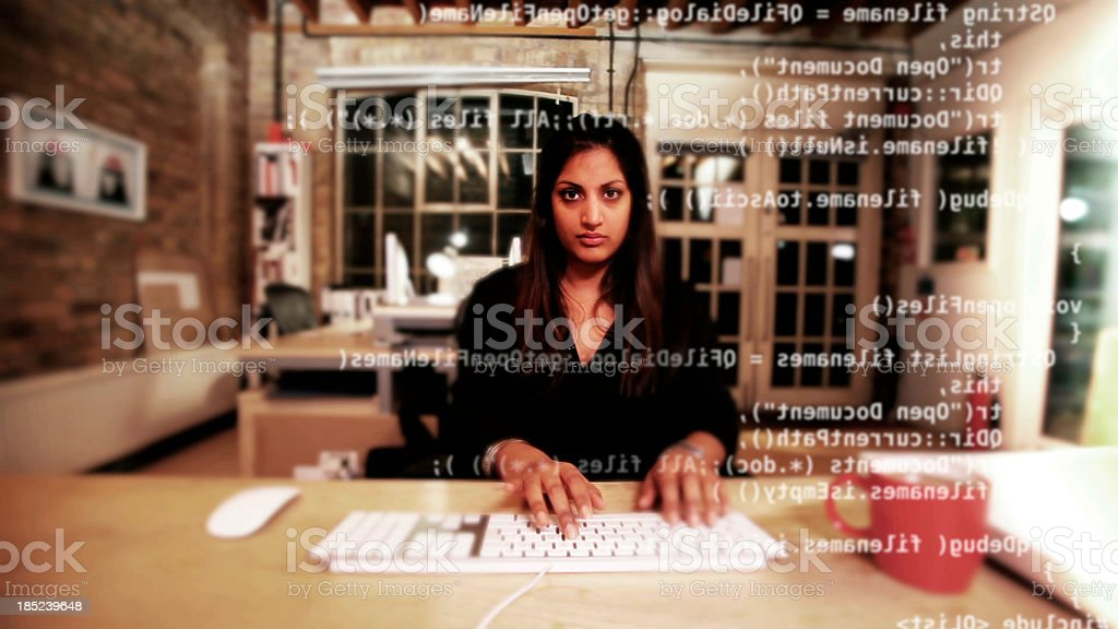 Computer programmer typing code stock photo