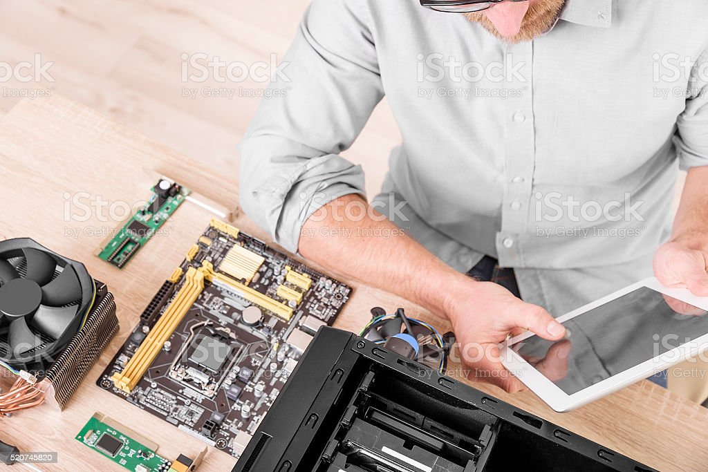 Computer repair professional stock photo