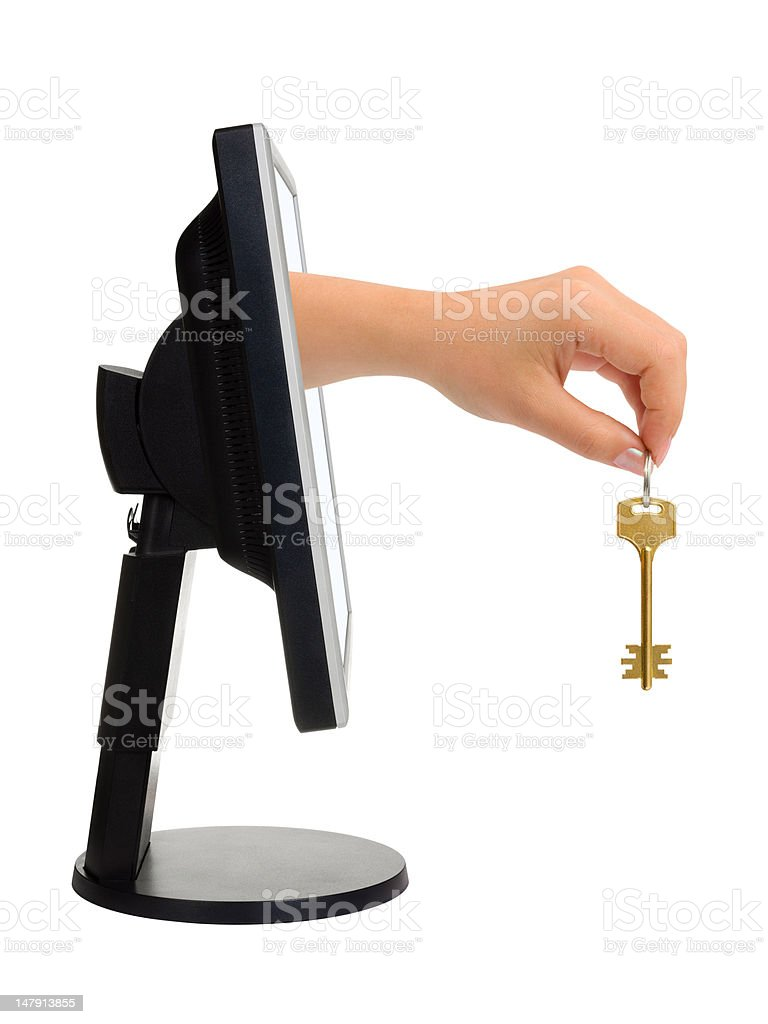 Computer screen and hand with key royalty-free stock photo