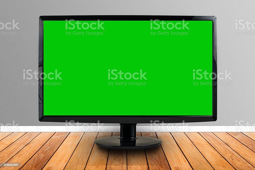 computer screen on wooden floor stock photo