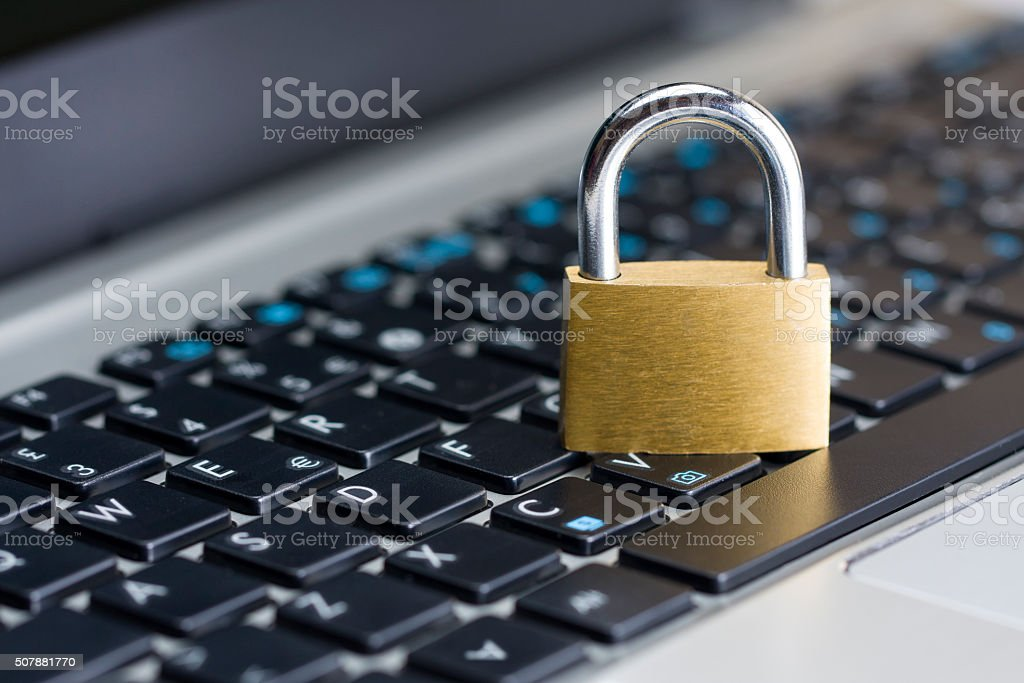 Computer security concept  closed padlock on keyboard stock photo