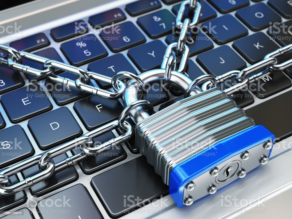 Computer security or safety concept. Laptop keyboard with lock a stock photo