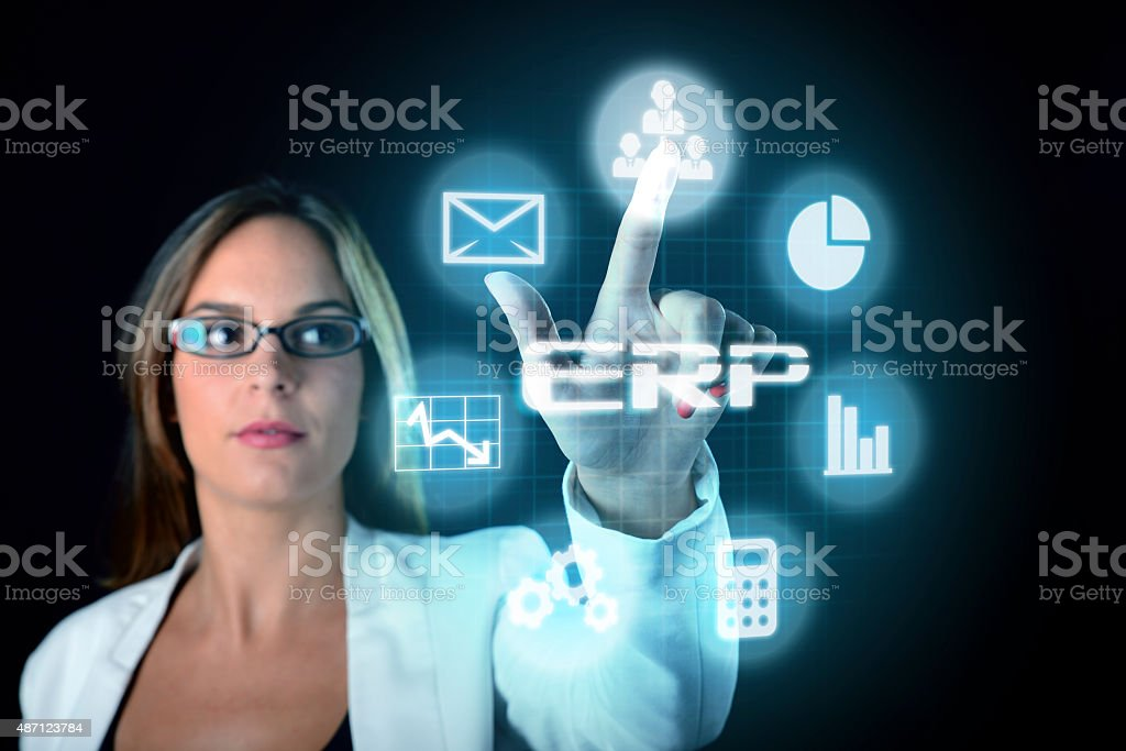 ERP computer software concept businesswoman selecting interface stock photo