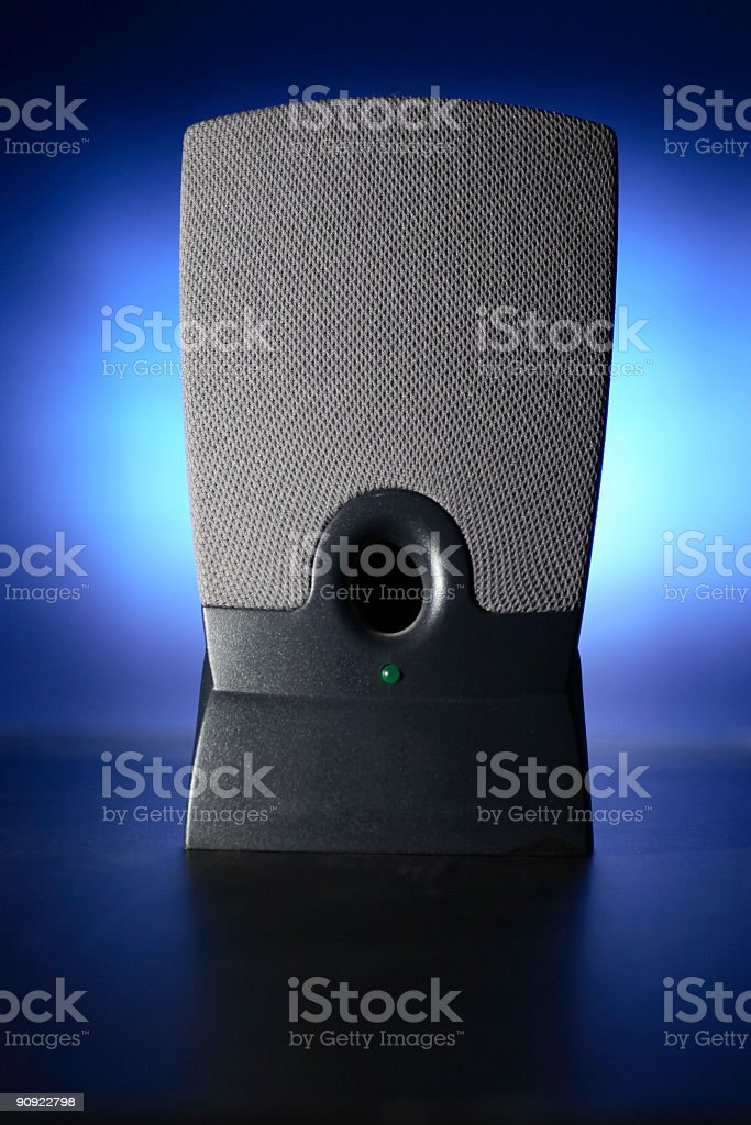 Computer Speaker on Glowing Blue Background stock photo