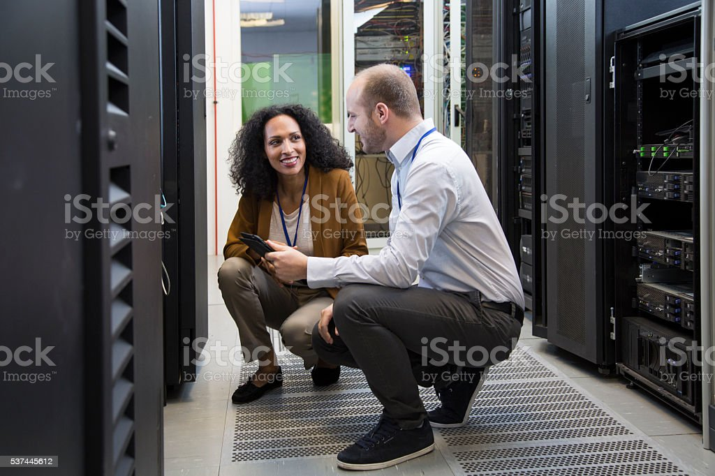 Computer technician in server room stock photo