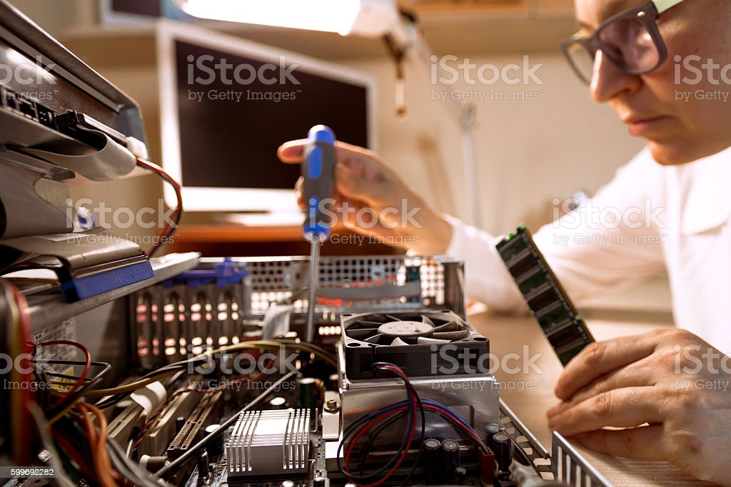 Computer Technician repairing Hardware with tools stock photo