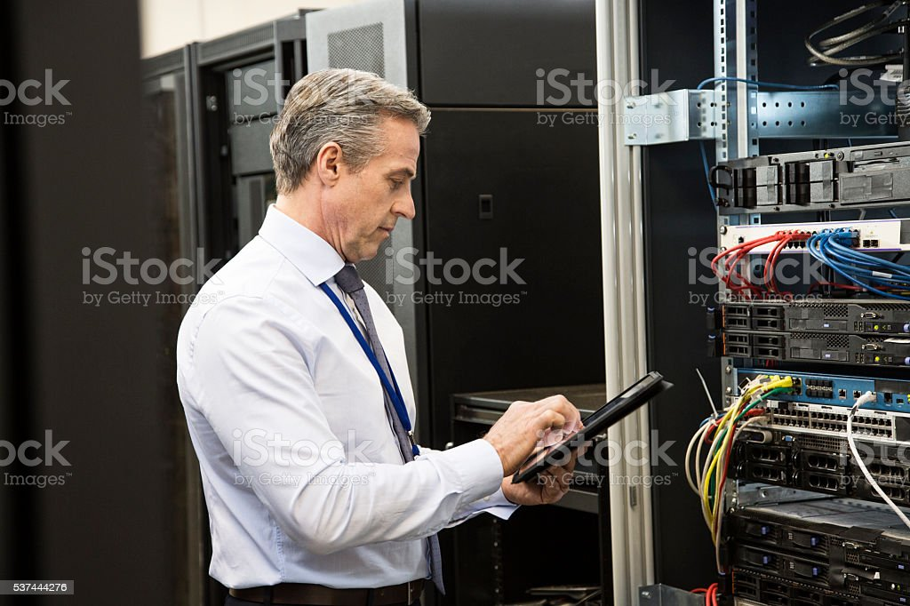 Computer technician using tablet stock photo