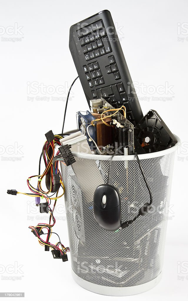 Computer trash in wastebasket stock photo