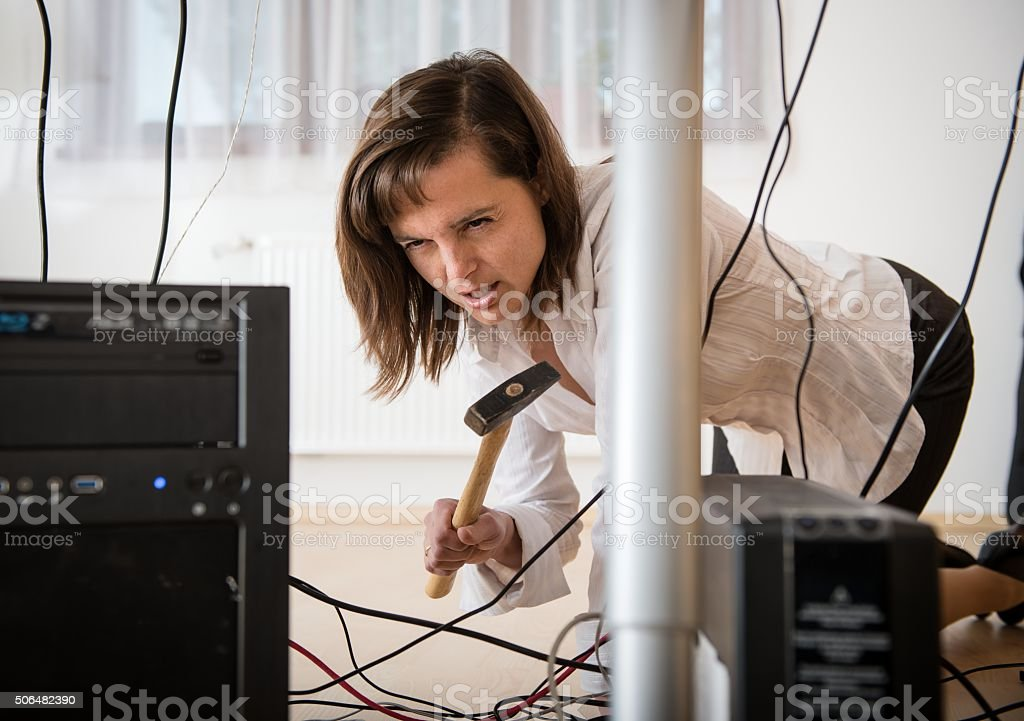 Computer troubles - angry business woman stock photo