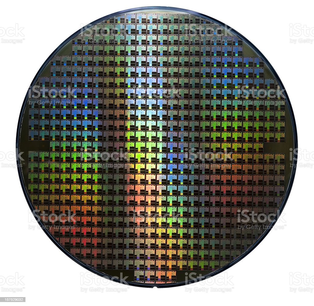 Computer wafer showing rainbow color patterns stock photo