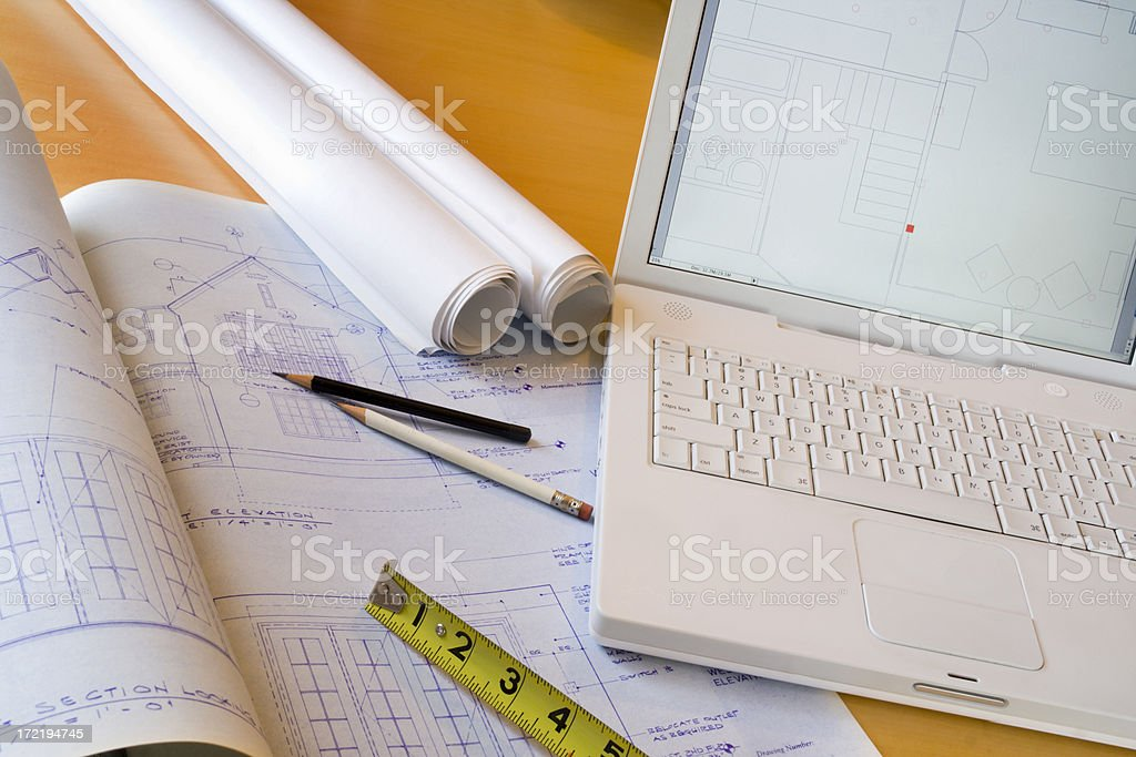 Computer with Architectural Blueprints, Construction Industry Tools and Floor Plans stock photo
