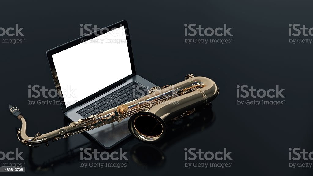 computer with saxophone stock photo