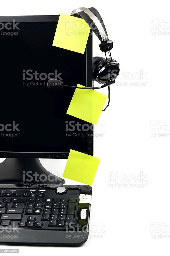 computer with VOIP headset and sticky notes royalty-free stock photo