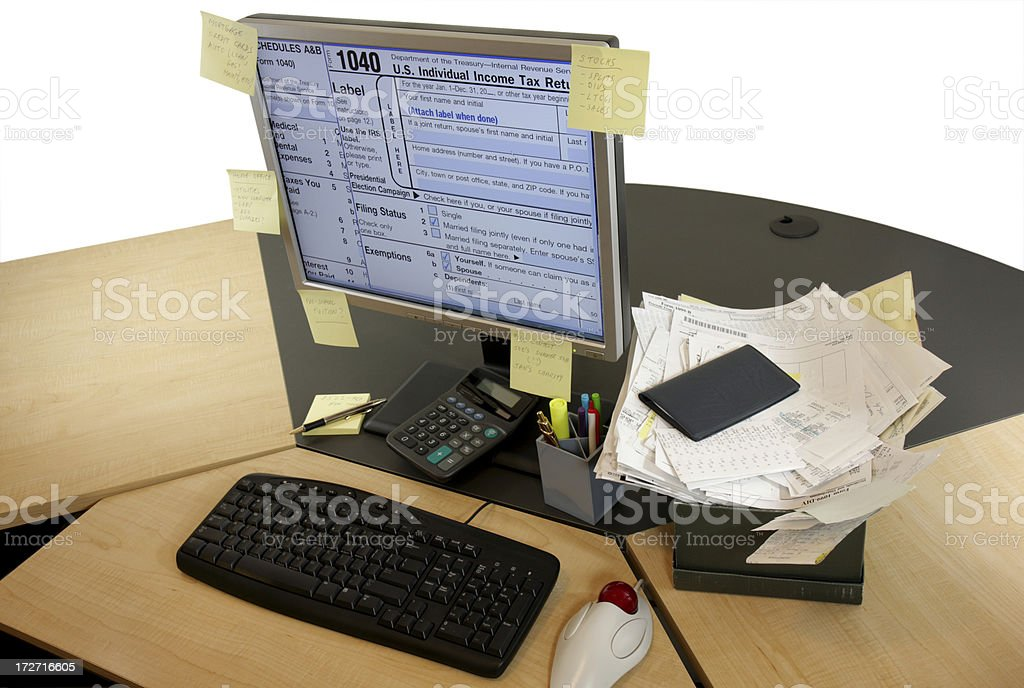 Computer workstation ready for taxes royalty-free stock photo