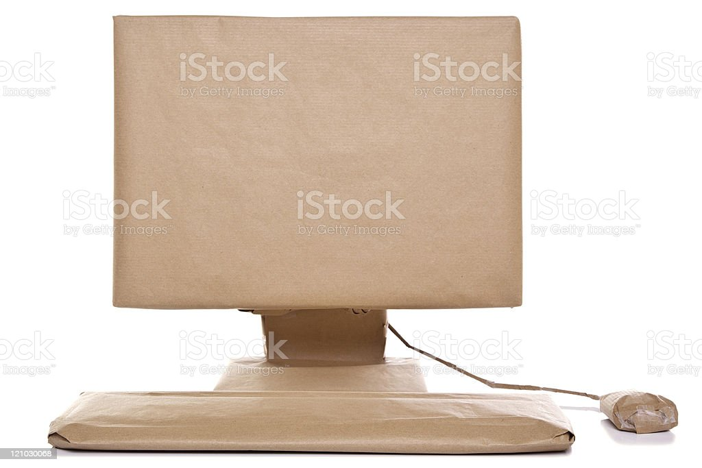 Computer wrapped in brown paper stock photo