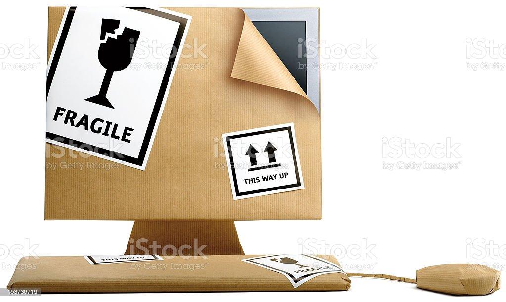 computer verpackt in Packpapier Lizenzfreies stock-foto