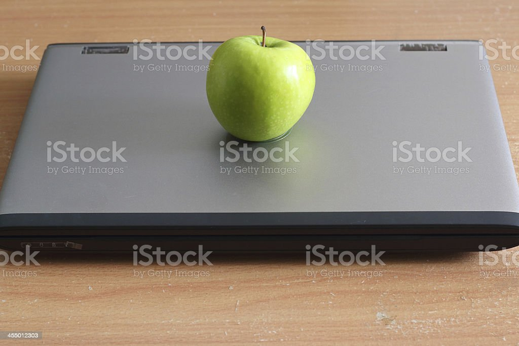 Computerand Apple royalty-free stock photo