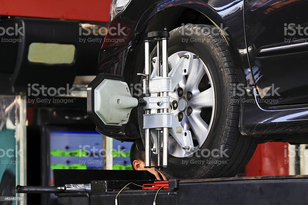 computerized wheel alignment machine clamp stock photo