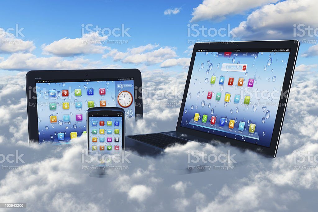 Computers and smartphones acessing the cloud stock photo