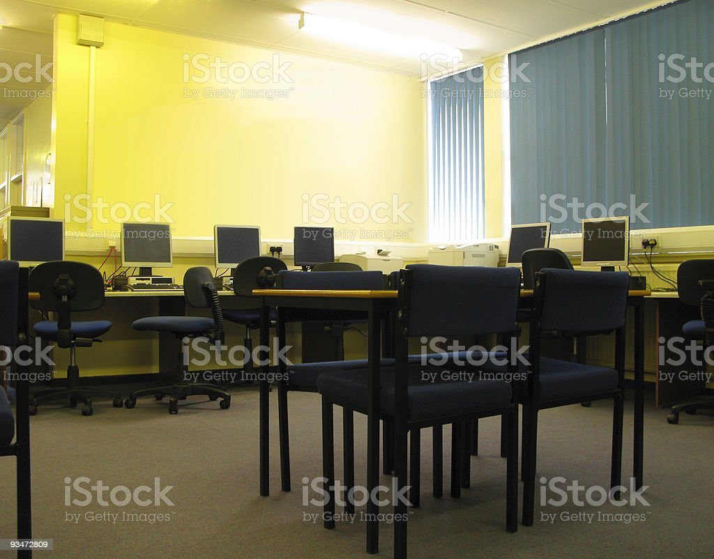 Computers in school library stock photo