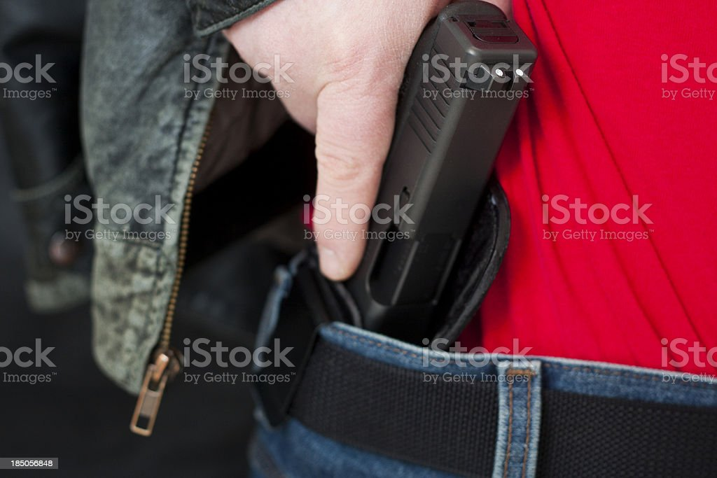 Concealed Carry Firearm Drawn From an Inside-the-Waistband Holst stock photo