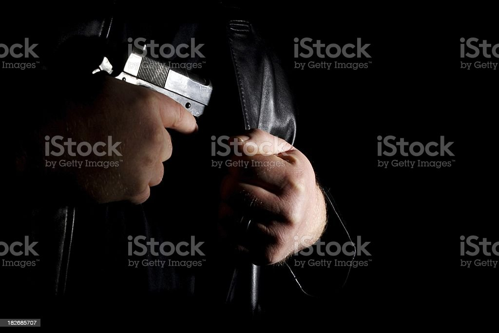 Concealed Carry Firearm Drawn From Inside A Leather Jacket stock photo