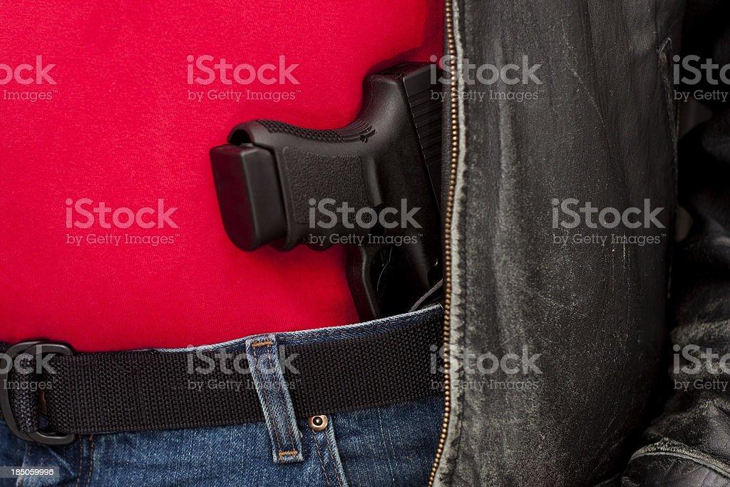 Concealed Firearm Under Jacket stock photo
