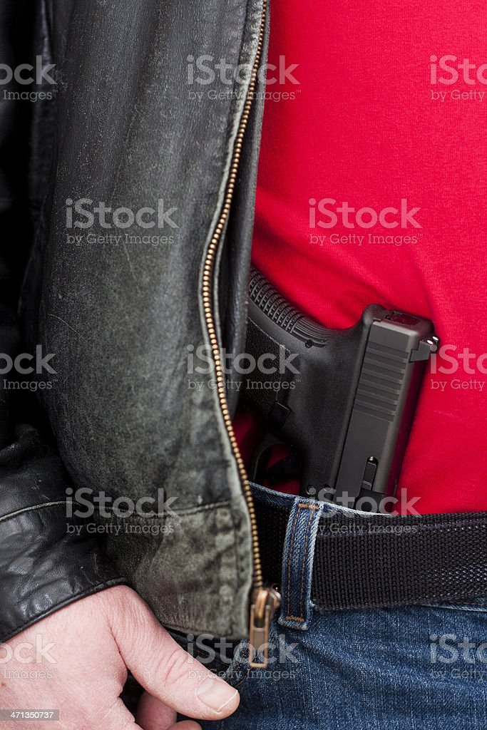 Concealed (Mexican Carry) Firearm Under Jacket stock photo