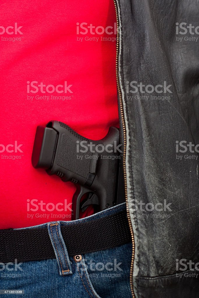 Concealed Firearm Under Jacket stock photo