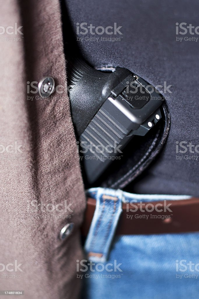 Concealed Firearm Under Shirt stock photo