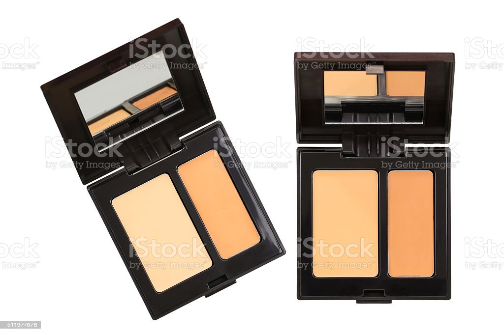 Concealer palettes in different shades isolated on white stock photo