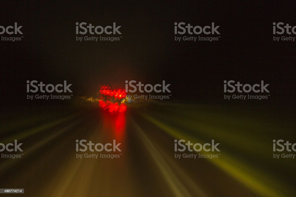 View from double-decker bus showing light traces, rays of light and...