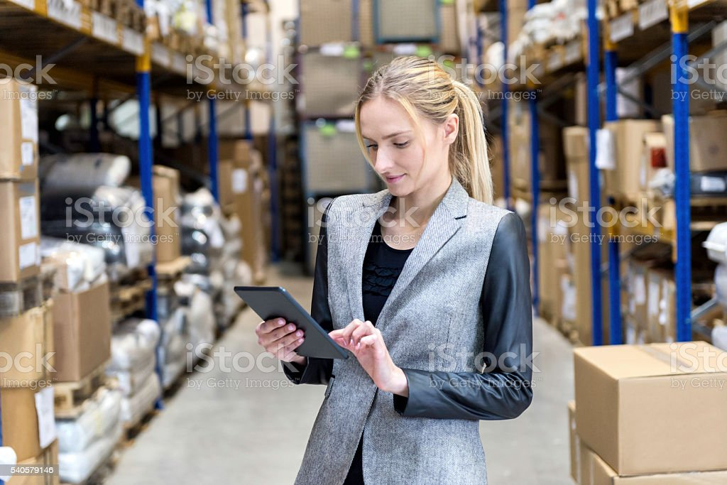 Concentrated business woman searching on tablet stock photo