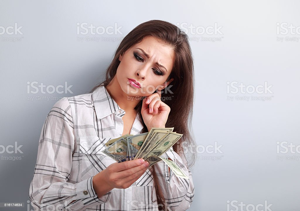 Concentrated business woman thinking where invest money stock photo