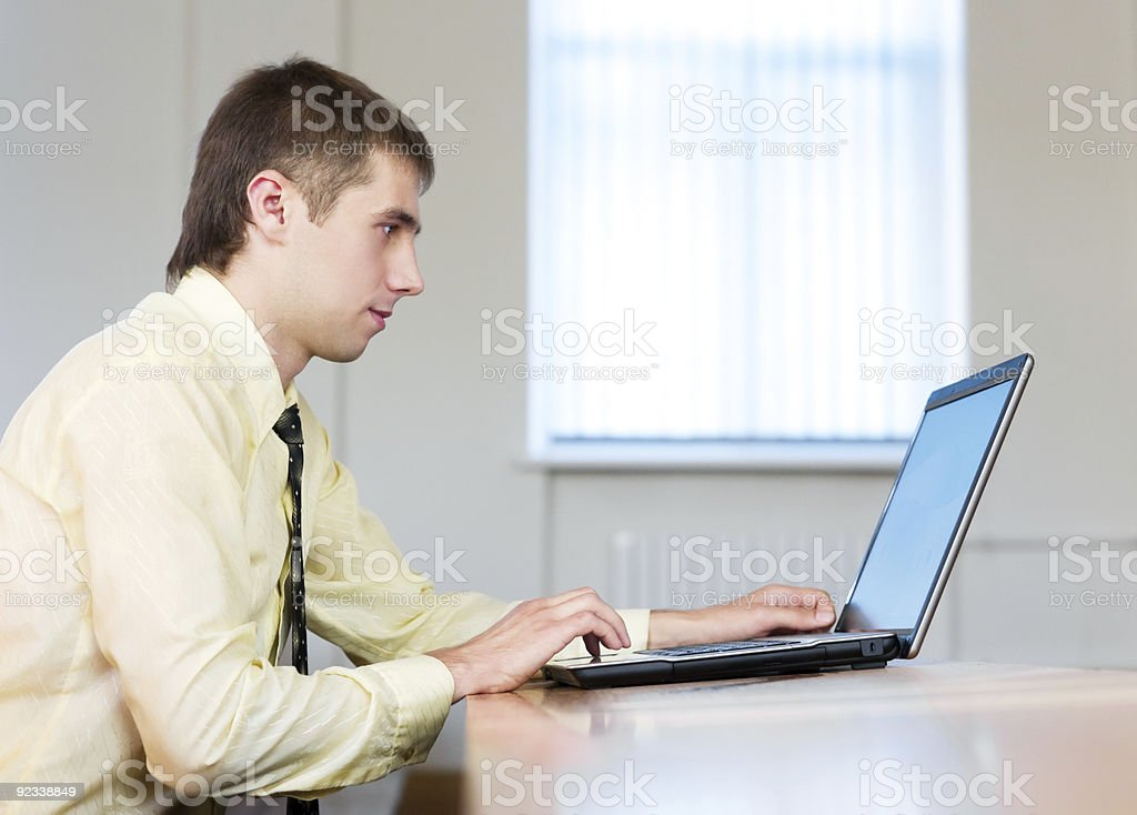 Concentrated businessman with laptop royalty-free stock photo