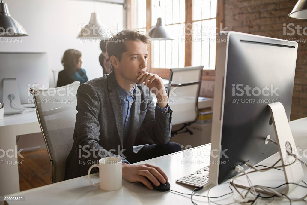 Concentrated businessman working in the office stock photo
