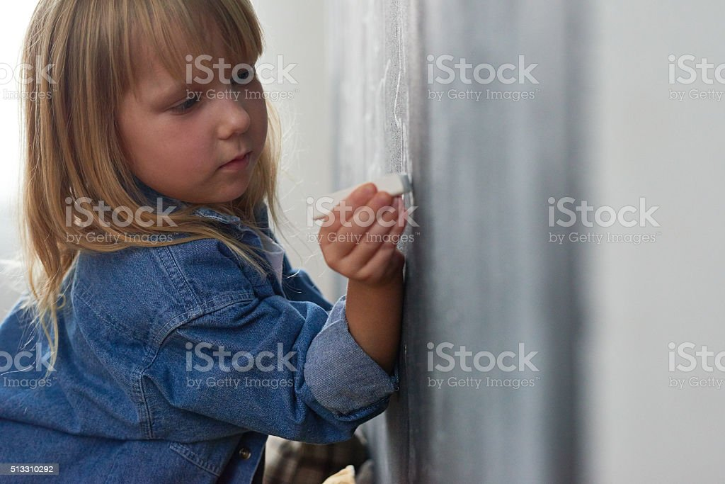 Concentrated girl stock photo