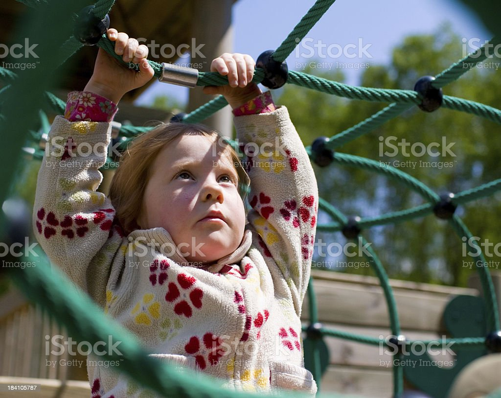 Concentrated little girl, holding tight royalty-free stock photo