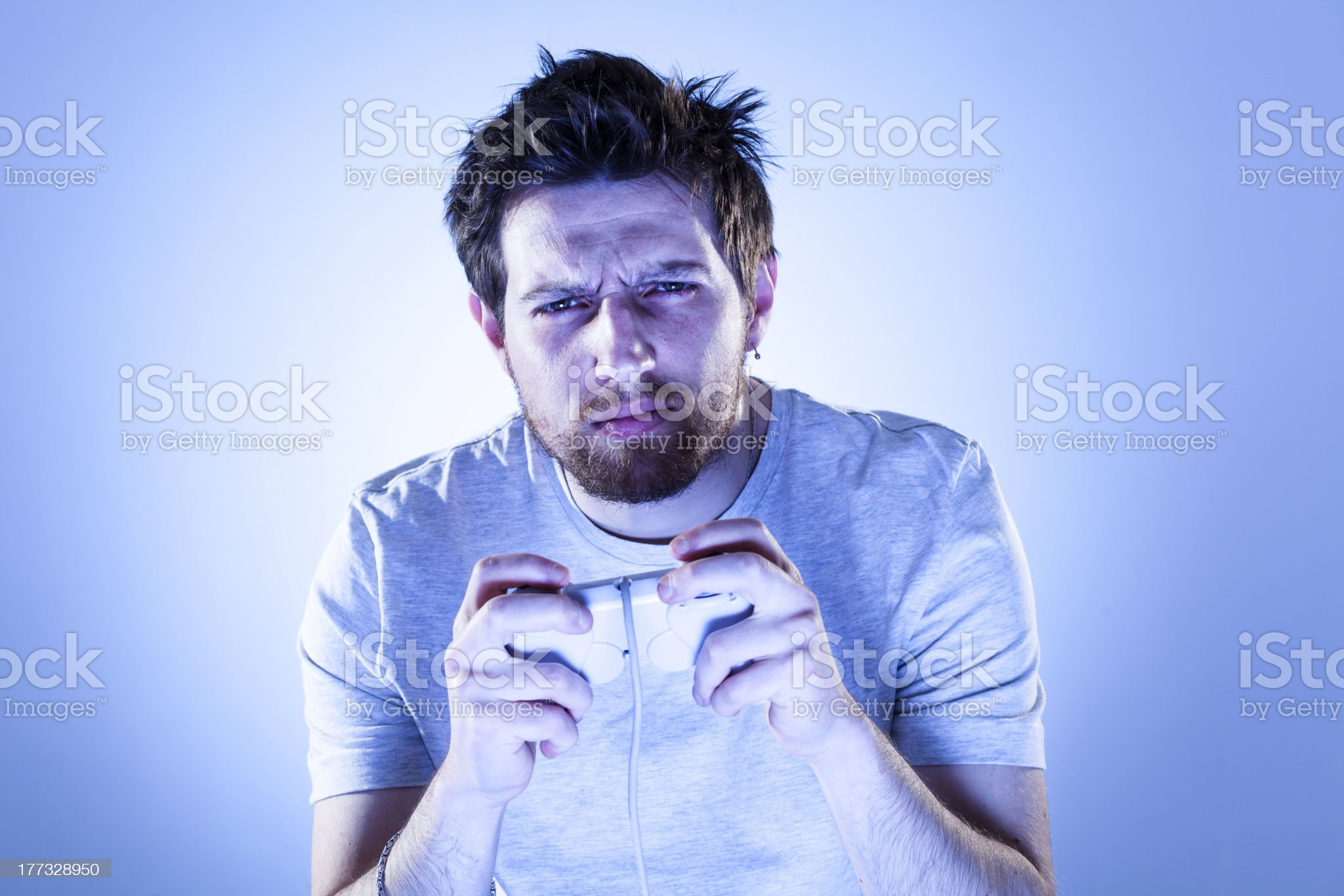 Concentrated Man with Gamepad royalty-free stock photo