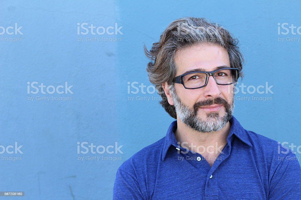 Concentrated man with pensive playful expression stock photo
