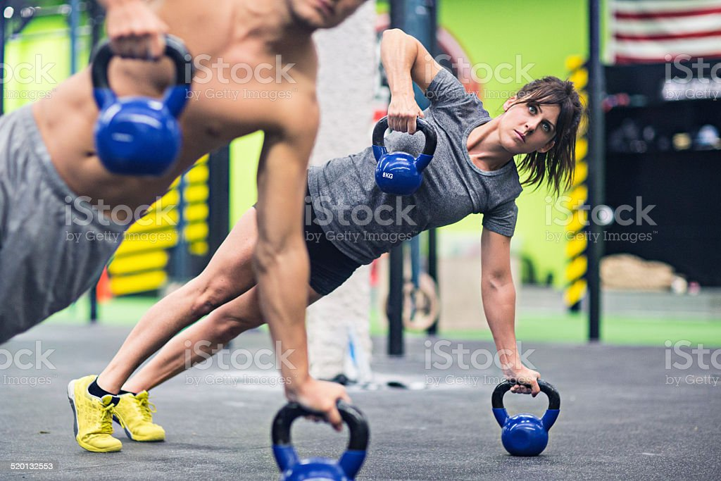 Concentrated on the pushups stock photo