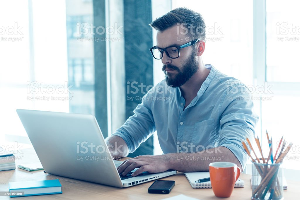 Concentrated on work. stock photo